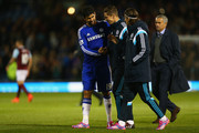 Diego Costa, Fernando Torres and Filipe Luis of Chelsea share a joke as Manager Jose Mourinho of Chelsea looks on after the Barclays Premier League match between Burnley and Chelsea at Turf Moor on August 18, 2014 in Burnley, England.
