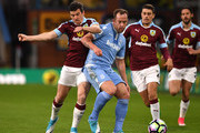 Joey Barton of Burnley (L) and Glenn Whelan of Stoke City (R) battle for possession during the Premier League match between Burnley and Stoke City at Turf Moor on April 4, 2017 in Burnley, England.