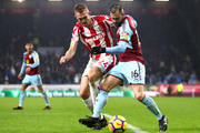 Darren Fletcher of Stoke City and Steven Defour of Burnley in action during the Premier League match between Burnley and Stoke City at Turf Moor on December 12, 2017 in Burnley, England.