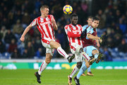 Jack Cork of Burnley clashes with Mame Biram Diouf and Darren Fletcher of Stoke City and during the Premier League match between Burnley and Stoke City at Turf Moor on December 12, 2017 in Burnley, England.