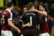 Joey Barton of Burnley, Thomas Heaton of Burnley and George Boyd of Burnley emrbace each other after the Premier League match between Burnley and Stoke City at Turf Moor on April 4, 2017 in Burnley, England.