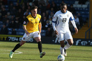 Kelvin Etuhu of Bury looks to play the ball watched by Diego De Girolamo of Northampton Town during the League Two match between Bury and Northampton Town at The JD Stadium on March 21, 2015 in Bury, England. (Photo by Pete Norton/Getty Images).Images)