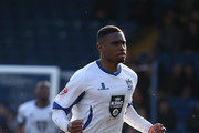Kelvin Etuhu of Bury celebrates after scoring his sides 1st goal during the League Two match between Bury and Northampton Town at Gigg Lane on March 21, 2015 in Bury, England.
