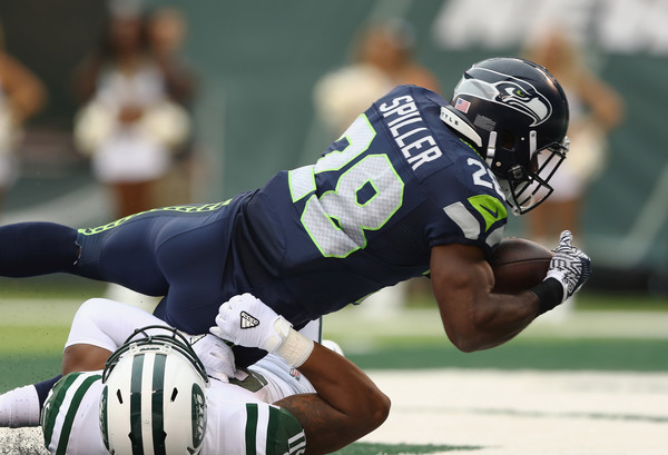 Seattle Seahawks v New York Jets [player,sports gear,sports,helmet,gridiron football,football gear,american football,sports equipment,canadian football,sprint football,c.j. spiller,new jersey,east rutherford,metlife stadium,seattle seahawks,new york jets,touchdown]