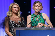 Paris Hilton and Paris Jackson speak onstage during the CASA Of Los Angeles' 2018 Evening To Foster Dreams Galaat The Beverly Hilton Hotel on April 18, 2018 in Beverly Hills, California.
