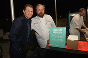 Chef Bobby Flay and Brian Ray attend the CASAMIGOS Tequila presents Tacos & Tequila: A Late Night Fiesta hosted by Bobby Flay during the New York City Wine & Food Festival at Esurance Rooftop Pier 92 on October 18, 2014 in New York City.