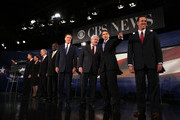 Republican presidential candidates (L-R) former Utah Governor Jon Huntsman, Rep. Michele Bachmann (R-MN), Rep. Ron Paul (R-TX), businessman Herman Cain, former Massachusetts Governor Mitt Romney, former Speaker of the House Newt Gingrich (R-GA), Texas Governor Rick Perry, and former Sen. Rick Santorum (R-PA) acknowledge audience prior to a presidential debate at Wofford College November 12, 2011 in Spartanburg, South Carolina. The debate was focused on national security and foreign policy.