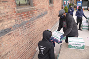 Former professional baseball player CC Sabathia distributes pantry boxes to Boys And Girls Club families at the Belmont Community Day Care Center on April 08, 2020 in The Bronx Borough of New York City.