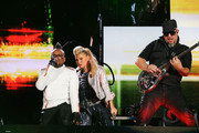 """apl.de.ap, Fergie, and George Pajon, Jr. of The Black Eyed Peas perform onstage during CHASE Presents The Black Eyed Peas and Friends """"Concert 4 NYC"""" benefiting the Robin Hood Foundation at Central Park, Great Lawn on September 30, 2011 in New York City."""