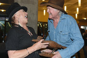 Artist Tanya Tucker and (L) and singer-songwriter Billy Joe Shaver (R) attend the CMHOF Outlaws and Armadillos VIP Opening Reception on May 24, 2018 in Nashville, Tennessee.
