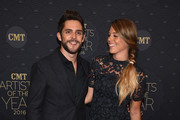 Singer-songwriter Thomas Rhett (L) and Lauren Gregory (R) arrive on the red carpet at CMT Artists of the Year 2016 on October 19, 2016 in Nashville, Tennessee.