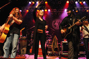 Singers and songwriter Kellie Pickler (C) joins Jamey Johnson and Randy Houser on stage during the CMT Tour at the Wildhorse Saloon on December 8, 2009 in Nashville, Tennessee.