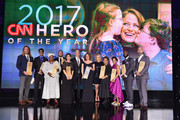 (L-R) Andrew Manzi, Samir Lakhani, Rosie Mashale, Stan Hays, Leslie Morissette, Anderson Cooper, Amy Wright, Kelly Ripa, Jennifer Maddox, Mona Patel, Khali Sweeney, and Aaron Valencia pose onstage during CNN Heroes 2017 at the American Museum of Natural History on December 17, 2017 in New York City. 27437_017