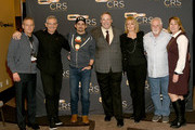 (L-R) Randy Goodman CEO, Chairman of Sony Music Nashville, RJ Curtis Vice President VP Country, Nashville Editor & All Access Music Group, artist Brad Paisley, Country Radio Broadcasters, Inc. Executive Director Bill Mayne, Beverlee Brannigan Secretary Operations Manager of E.W. Scripps, manager Bill Simmons, Sarah Trahern CEO of CMA take photos during day 2 of CRS 2018 on February 6, 2018 in Nashville, Tennessee.