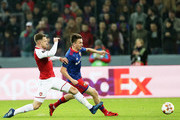 Alexander Golovin of PFC CSKA Moskva vies for the ball with Aaron Ramsey of Arsenal FC during the UEFA Europa League quarter final leg two match between PFC CSKA Moskva and Arsenal FC at CSKA Arena stadium on April 12, 2018 in Moscow, Russia.
