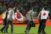 Aaron Ramsey of Arsenal is stretchered from the pitch during the UEFA Europa League quarter final leg two match between PFC CSKA Moskva and Arsenal FC at CSKA Arena stadium on April 12, 2018 in Moscow, Russia.