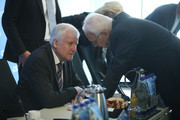In this image shot through a pain of glass Horst Seehofer (L), Chairman of the Bavarian Social Union (CSU), and leading CSU member Edmund Stoiber speak with one another prior to a meeting of the CSU leadership at party headquarters on October 15, 2018 in Munich, Germany. The CSU faired poorly in the election, winning 37.2% of the vote, 10.5 votes fewer than in the last election. The CSU has long been Bavaria's strongest party but will now face the arduous task of forming a state government coalition.
