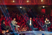 """Mentors Gloria Estefan, Nelly, Joe Jonas and John Rich sit on stage during a live taping of CW's """"The Next"""" on August 7, 2012 in Dallas, Texas."""