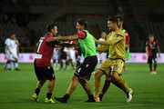 Andrea Cossu (L) of Cagliari Calcio celebrates the victory with team mates at the end of  the TIM Cup match between Cagliari Calcio and US Citta di Palermo at Stadio Olimpico on August 12, 2017 in Turin, Italy.