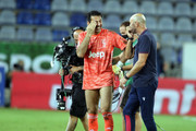 Gianluigi Buffon  of Juventus and Walter Zenga speak at the end of the race during the Serie A match between Cagliari Calcio and  Juventus at Sardegna Arena on July 29, 2020 in Cagliari, Italy.