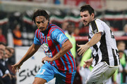 Sebastian Leto (L) of Catania competes for the ball with Andrea Lazzari of Udinese during the Serie A match between Calcio Catania and Udinese Calcio at Stadio Angelo Massimino on November 9, 2013 in Catania, Italy.