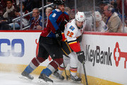 Drew Shore #22 of the Calgary Flames controls the puck against Jan Hejda #8 of the Colorado Avalanche at Pepsi Center on March 14, 2015 in Denver, Colorado.