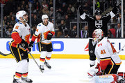 Tyler Toffoli #73 of the Los Angeles Kings celebrates a goal from Dion Phaneuf #3, in front of Mike Smith #41, Mark Giordano #5 and Travis Hamonic #24 of the Calgary Flames to take a 1-0 lead during the second period at Staples Center on March 26, 2018 in Los Angeles, California.