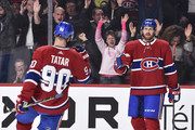 Jeff Petry #26 of the Montreal Canadiens celebrates his second-period goal with teammate Tomas Tatar #90 against the Calgary Flames during the NHL game at the Bell Centre on October 23, 2018 in Montreal, Quebec, Canada.
