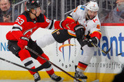 Mark Giordano #5 of the Calgary Flames clears the puck in the first period from Jesper Bratt #63 of the New Jersey Devils on February 8, 2018 at Prudential Center in Newark, New Jersey.