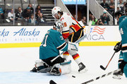 Martin Jones #31 of the San Jose Sharks makes a save on a shot taken by James Neal #18 of the Calgary Flames during their preseason game at SAP Center on September 27, 2018 in San Jose, California.