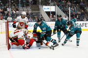 Mike Smith #41 and Travis Hamonic #24 of the Calgary Flames stop Rourke Chartier #60 and Marcus Sorensen #20 of the San Jose Sharks from scoring during their preseason game at SAP Center on September 27, 2018 in San Jose, California.