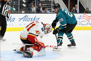 Mike Smith #41 of the Calgary Flames makes a save on a shot taken by Timo Meier #28 of the San Jose Sharks during their preseason game at SAP Center on September 27, 2018 in San Jose, California.