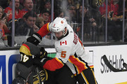 Mark Giordano #5 of the Calgary Flames pushes Ryan Carpenter #40 of the Vegas Golden Knights down as they go after a loose puck in the second period of their game at T-Mobile Arena on February 21, 2018 in Las Vegas, Nevada. The Golden Knights won 7-3.