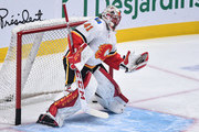Goaltender Mike Smith #41 of the Calgary Flames gloves the puck in the warm-up prior to the NHL game against the Montreal Canadiens at the Bell Centre on October 23, 2018 in Montreal, Quebec, Canada.  The Montreal Canadiens defeated the Calgary Flames 3-2.