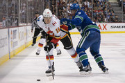 Brandon Sutter #20 of the Vancouver Canucks tries to check Matthew Tkachuk #19 of the Calgary Flames off the puck in NHL action on October, 3, 2018 at Rogers Arena in Vancouver, British Columbia, Canada.