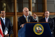 California Gov. Jerry Brown surrounded by Los Angeles City and California State officials speaks before signing a legislation authorizing initial construction of California's $68 billion high-speed rail line at Union Station on July 18, 2012 in Los Angeles, California. The bill authorizes $10 billion in state bonds to start construction of a high-speed rail line between Los Angeles and San Francisco.