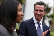 California Lt. Gov. and California gubernatorial candidate Gavin Newsom (R) looks on as San Francisco mayor London Breed (L) speaks with members of the media as they visits the Alice Griffith Apartments on August 22, 2018 in San Francisco, California. Lt. Gov. Gavin Newsom and San Francisco mayor London Breed toured a low-income housing complex. Newsom leads Republican gubernatorial candidate John Cox by an average of 23 percentage points in recent polls.