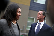 California Lt. Gov. and California gubernatorial candidate Gavin Newsom (R) and San Francisco mayor London Breed (L) look on as they visit the Alice Griffith Apartments on August 22, 2018 in San Francisco, California. Lt. Gov. Gavin Newsom and San Francisco mayor London Breed toured a low-income housing complex. Newsom leads Republican gubernatorial candidate John Cox by an average of 23 percentage points in recent polls.