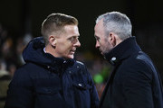 Garry Monk manager of Leeds United and Shaun Derry manager of Cambridge United in discussion prior to the Emirates FA Cup Third Round match between Cambridge United and Leeds United at Cambs Glass Stadium on January 9, 2017 in Cambridge, England.