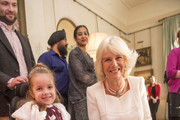 Maya Czerminska meets Camilla, Duchess of Cornwall during a reception at Clarence House hosted by the Duchess of Cornwall, for youngsters and their carers from Helen and Douglas House on December 11, 2013 in London, England.