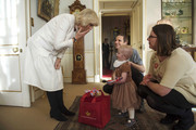 Lorna Gentry meets Camilla, Duchess of Cornwall during a reception at Clarence House hosted by the Duchess of Cornwall, for youngsters and their carers from Helen and Douglas House on December 11, 2013 in London, England.