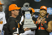 Head coach Mike Gundy of the Oklahoma State Cowboys holds the Camping World Bowl Trophy after defeating the Virginia Tech Hokies on December 28, 2017 at Camping World Stadium in Orlando, Florida.