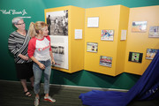 Chairman of the Little League Board of Directors Dr. Davie Jane Gilmour and actress Candace Cameron Bure unveil the Canon Little League Photo Contest winners in the Richard 'Hank' Bauer, Jr. Little League Photography Exhibit  at the Little League World Series on August 21, 2016 in South Williamsport, Pennsylvania.