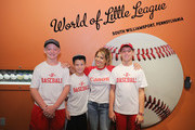 Actress Candace Cameron Bure (C) poses with Little League fans at the Little League World Series on August 21, 2016 in South Williamsport, Pennsylvania.