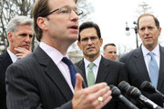 """U.S. Rep. Peter Roskam (R-IL) (2nd L) speaks as (L-R) House Majority Whip Rep. Kevin McCarthy (R-CA), House Majority Leader Rep. Eric Cantor (R-VA), and Rep. Dave Camp (R-MI) listen during a news conference March 21, 2012 on Capitol Hill in Washington, DC. Rep. Cantor and other House Republicans held a news conference to unveil the """"Small Business Tax Cut Act of 2012."""""""