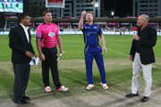 Paul Collingwood the Captain of Capricorn Commanders performs the coin toss as Jacques Kallis the Captain of Libra Legends looks on prior to the Oxigen Masters Champions League match between Capricorn Commanders and Libra Legends on February 5, 2016 in Sharjah, United Arab Emirates.