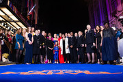 "Lashana Lynch, Anna Boden, Brie Larson, Gemma Chan and Victoria Alonso with British servicewomen, policewomen, scientists and sportswomen as they attend the ""Captain Marvel European Gala"" held at The Curzon Mayfair on February 27, 2019 in London, England."