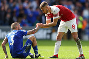 Aaron Ramsey of Arsenal shakes hands with Joe Bennett of Cardiff City after the Premier League match between Cardiff City and Arsenal FC at Cardiff City Stadium on September 2, 2018 in Cardiff, United Kingdom.