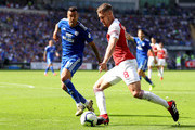 Aaron Ramsey of Arsenal is watched by Victor Camarasa of Cardiff City during the Premier League match between Cardiff City and Arsenal FC at Cardiff City Stadium on September 2, 2018 in Cardiff, United Kingdom.