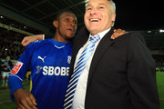 Kelvin Etuhu of Cardiff City celebrates with Manager Dave Jones after winning the Coca-Cola Championship Playoff Semi Final 2nd Leg between Cardiff City and Leicester City at Cardiff City Stadium on May 12, 2010 in Cardiff, Wales.